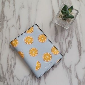 COACH PASSPORT CASE WITH ORANGE PRINT
